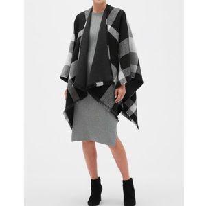 Reversible black & white plaid poncho. NWT